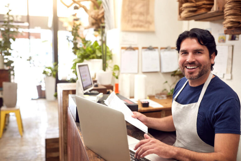 Happy Business Owner With Small Business Loans